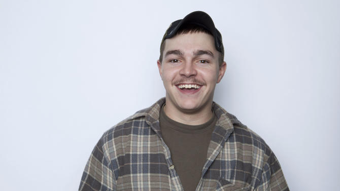 """FILE - This Jan. 2, 2013 file photo shows Shain Gandee, from MTV's """"Buckwild"""" reality series in New York. Gandee was found dead Monday, April 1,  in a sport utility vehicle in a ditch along with his uncle and a third, unidentified person, authorities said. Gandee died doing what made him famous: careening through huge mudholes in his SUV, taking chances most others won't, living free and reckless in front of reality-show TV cameras. His death further blurs the line between entertainment and real life in an age where fame is easier than ever to attain. (Photo by Amy Sussman/Invision/AP, file)"""