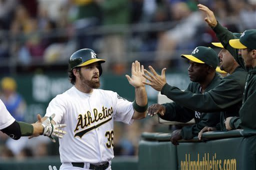 Cespedes, Moss homer to push A's past Rangers 5-1