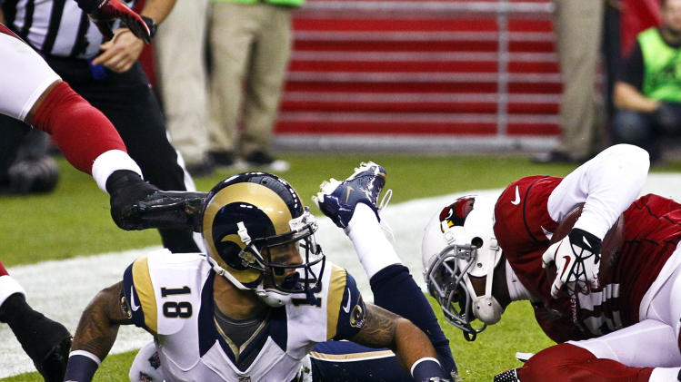 Arizona Cardinals' Patrick Peterson, right, intercepts a pass intended for St. Louis Rams' Austin Pettis (18) in the end zone during the first half in an NFL football game, Sunday, Nov. 25, 2012, in Glendale, Ariz. (AP Photo/Ross D. Franklin)