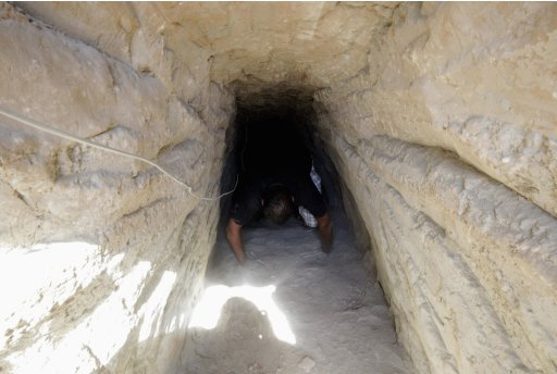 A man checks a tunnel linking Egypt and the Gaza Strip at Rafah city