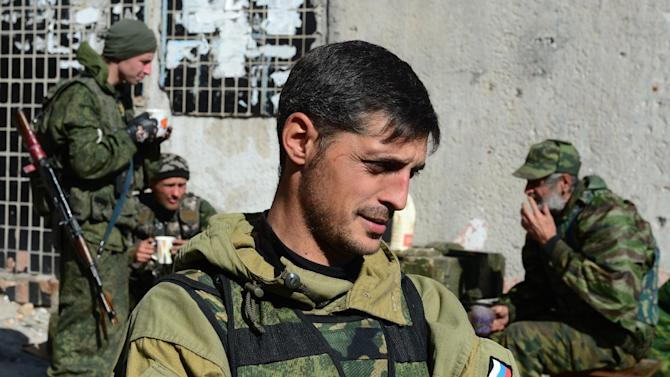 """Givi, commander of the pro-Russian separatist """"Somali battalion"""", speaks to reporters at a lookout centre near Donetsk's Sergey Prokofiev international airport, on October 9, 2014"""