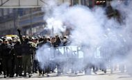 Police officers on strike march along the streets of La Paz, Bolivia. Rebel police clashed with pro-government supporters Monday outside Bolivia&#39;s presidential palace on the fifth day of a mutiny demanding better pay
