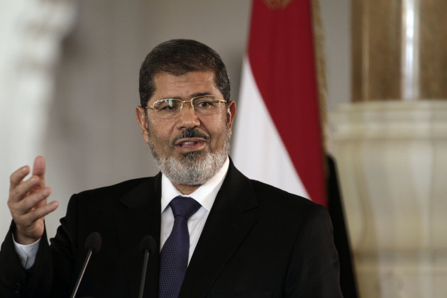 In this Friday, July 13, 2012 file photo, Egyptian President Mohammed Morsi speaks to reporters during a joint news conference with Tunisian President Moncef Marzouki, unseen, at the Presidential palace in Cairo, Egypt. An Egyptian presidential official said Saturday, Aug. 18, 2012 that President Mohammed Morsi will attend a summit of non-aligned nations in Iran end of the month, in first such visit in decades.
