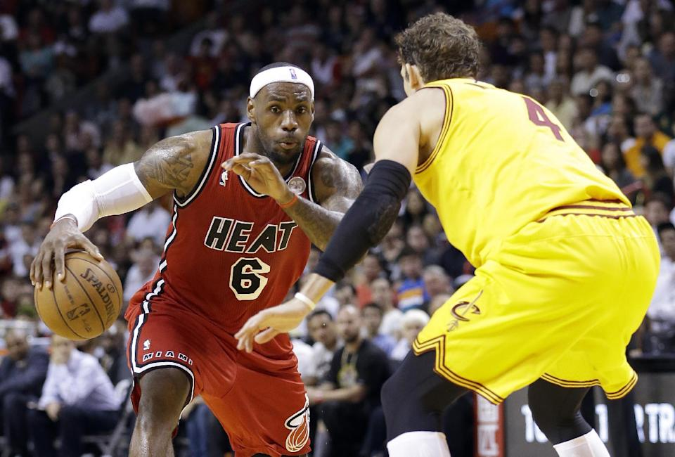 Miami Heat forward LeBron James (6) drives to the basket against Cleveland Cavaliers forward Luke Walton (4) during the first half of an NBA basketball game, Sunday, Feb. 24, 2013, in Miami. (AP Photo/Wilfredo Lee)