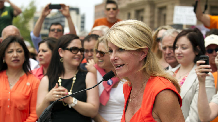 State Sen. Wendy Davis, D-Fort Worth, speaks at an abortion rights rally at the state Capitol in Austin, Texas, on Monday July 1, 2013. The Texas Senate has convened for a new 30-day special session to take up contentious abortion restrictions bill and other issues. (AP Photo/Statesman.com, Jay Janner)