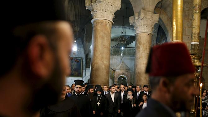 Greek Prime Minister Alexis Tsipras greets Greek Orthodox Patriarch of Jerusalem Metropolitan Theophilos at the Church of the Holy Sepulchre in Jerusalem's Old City