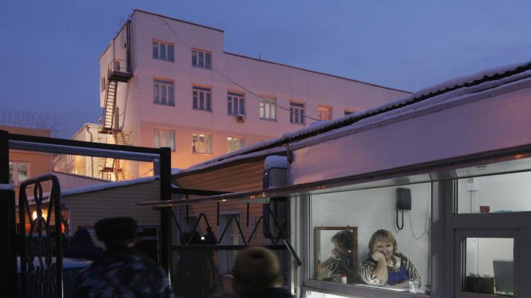 A vendor looks out of window of a small shop, located next to gates of Prison Hospital number 1, where Tolokonnikova of Pussy Riot is being held, in Krasnoyarsk