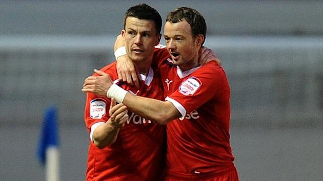 Reading's Ian Harte congratulated by team mate Noel Hunt after scoring their first goal