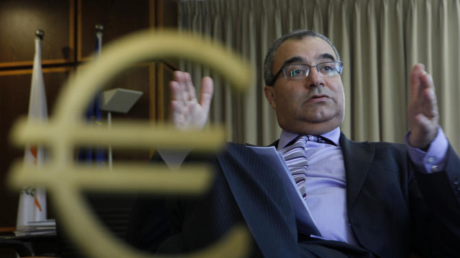 "Cyprus' Central Bank chief Panicos Demetriades gestures during an interview with The Associated Press at his office in central bank of Cyprus in capital Nicosia, Cyprus, Tuesday, Jan. 15, 2013. Demetriades said banks which took huge losses on Greek debt and loans will need ""less than €10 billion ($13.33 billion)"" to recapitalize, even in the worst-case scenario. (AP Photo/Petros Karadjias)"