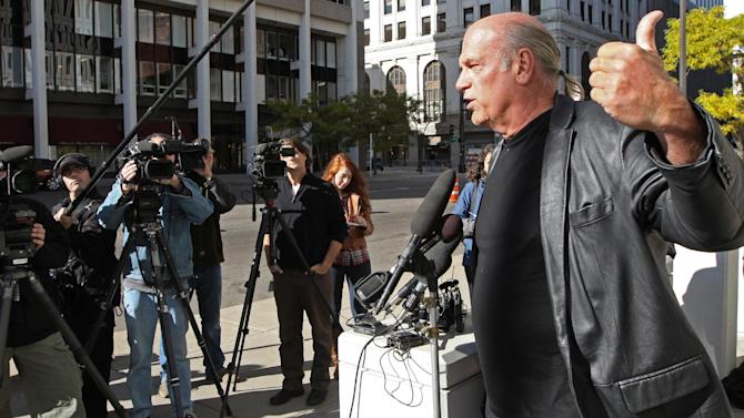 Former Minnesota Governor Jesse Ventura speaks to the media about the court dismissing his suit against the TSA for the pat downs at the airport, outside  the St. Paul Federal Courthouse on Friday, Nov. 4, 2011 in St. Paul.    Ventura sued the federal government in January, alleging that airport scans and pat-downs amounted to unreasonable search and seizure. A district judge in St. Paul threw out his lawsuit Thursday, ruling it should have been filed in a Circuit Court of Appeals. (AP Photo/The Star Tribune,  Bruce Bisping)