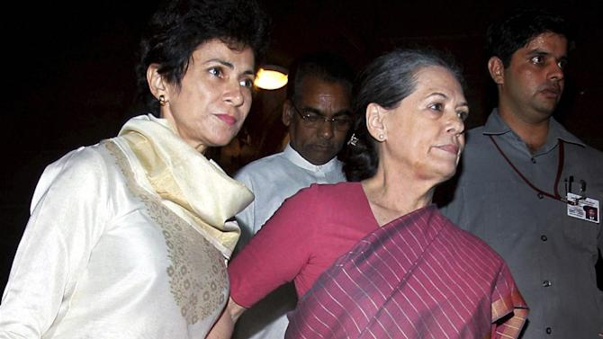 Indian minister for Social Justice and Empowerment Kumari Selja, left, escorts Chairman of ruling United Progressive Alliance and Congress party president Sonia Gandhi, right, as they walk out of Indian Parliament House during the debate on National Food Security Bill 2013, in New Delhi, India, Monday, Aug.26, 2013. News reports say Sonia Gandhi, India's most powerful politician and leader of the ruling Congress Party, is in stable condition after falling ill during a debate in Parliament. Gandhi has been suffering from a fever since Sunday. She appeared fine during a parliamentary speech earlier Monday, but reports said she had to be escorted from Parliament in the evening by colleagues and her son Rahul Gandhi (AP Photo)