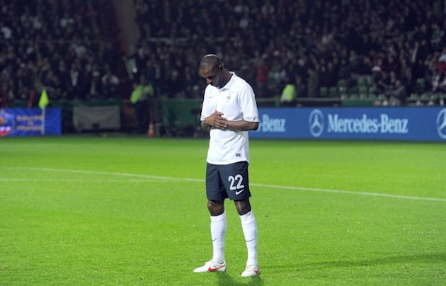 French Defender Eric Abidal Praying AFP/Getty Images