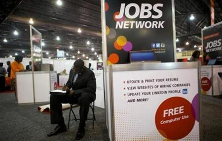 Job-seeker completes an application at a career fair held by civil rights organization National Urban League as part of its annual conference, in Philadelphia