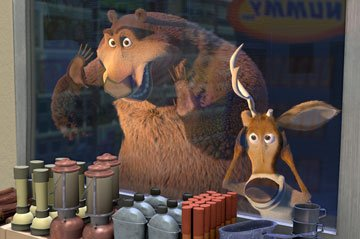 Boog the grizzly bear (voiced by Martin Lawrence ) and Elliot the mule deer (voiced by Ashton Kutcher ) in Columbia Pictures' Open Season
