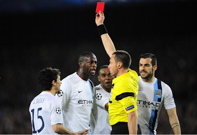 Manchester City players protest as referee Stephane Lannoy shows a red card to Manchester City's Pablo Zabaleta during a Champions League, round of 16, second leg, soccer match between FC Barcelon