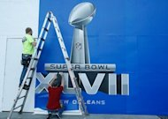 Workers put the finishing touches to a Super Bowl sign on January 29, 2013 in New Orleans. This Sunday, nearly 180 million Americans will settle in front of TV sets to watch the Super Bowl. For advertisers, it's a showcase like no other