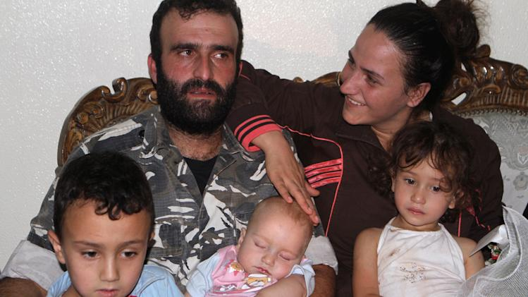 Lebanese Corporal Baradiy, who was captured by militants in Arsal, sits with his family after his release, in Baalbek