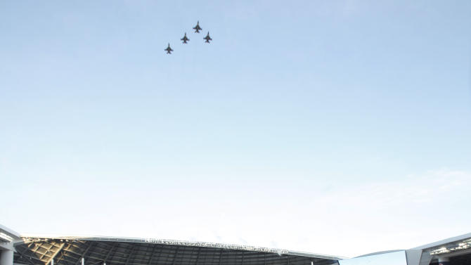 Fighter jets fly over Marlins Park after the national anthem before the Opening Day baseball game between the Miami Marlins and the St. Louis Cardinals, Wednesday, April 4, 2012, in Miami. (AP Photo/Wilfredo Lee)