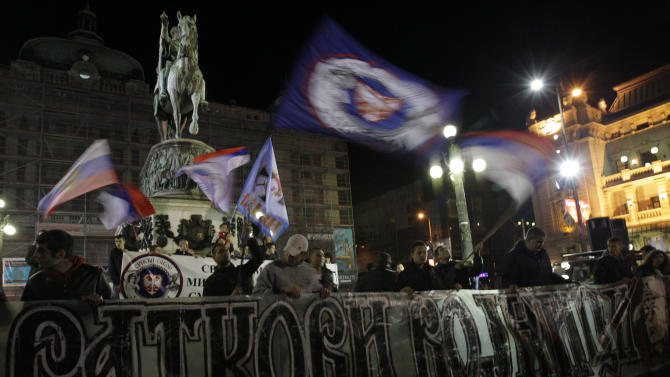 """Protesters wave Serbian flags and banner reads: """"Ratko's soldiers""""  (genocide suspect Bosnian Serb army commander Ratko Mladic) during the Serbian nationalists protest in Belgrade, Serbia, Thursday, Nov. 29, 2012. A U.N. war crimes tribunal on Thursday acquitted the former prime minister of Kosovo Ramush Haradinaj and two of his former Kosovo Liberation Army comrades for the second time of murdering and torturing Serbs and their supporters in Kosovo's war for independence. Serbian officials and media had been anticipating for days that Haradinaj would be acquitted less than two weeks after two Croatian generals were cleared of charges of killing and deporting Serbs in a 1995 military blitz, a judgment that sparked rage in Belgrade, where many see the tribunal as anti-Serb. (AP Photo/Darko Vojinovic)"""