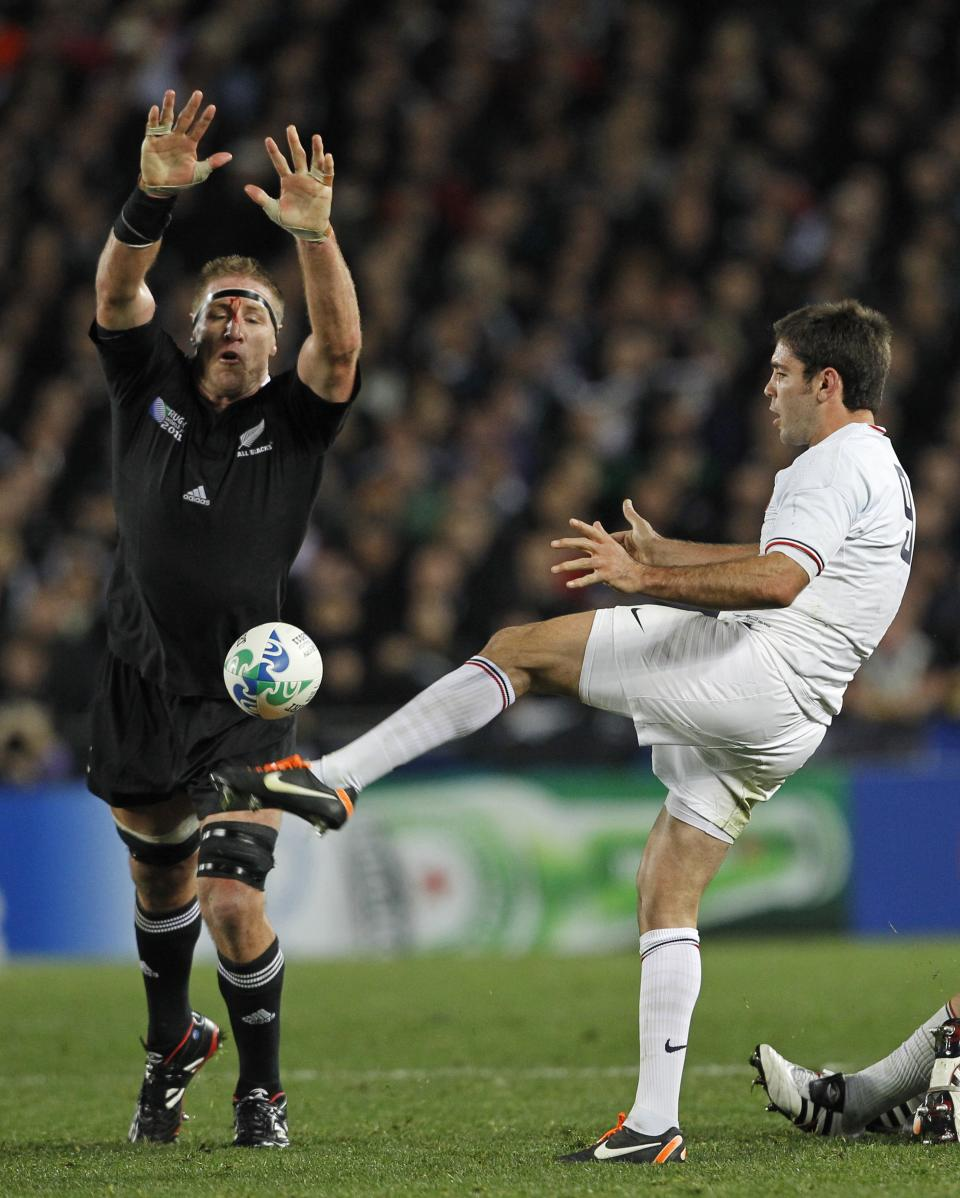 France's Dimitri Yachvili kicks the ball as New Zealand All Blacks Brad Thorn attempts to charge it down during their Rugby World Cup final at Eden Park in Auckland, New Zealand, Sunday, Oct. 23, 2011. (AP Photo/Christophe Ena)