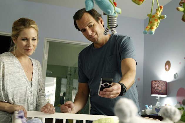 "Christina Applegate as Reagan and Will Arnett as Chris in ""Up All Night."""