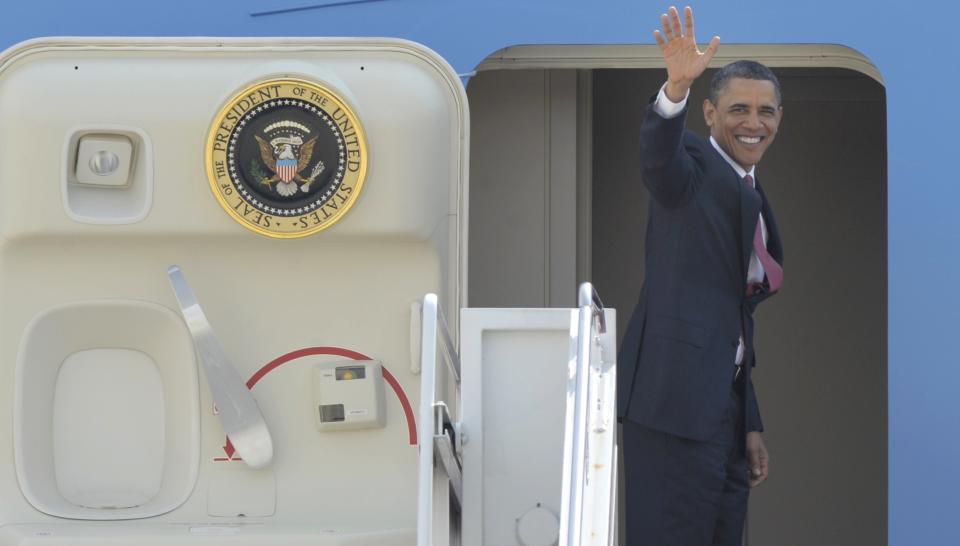 President Barack Obama waves prior to boarding Air Force One at Andrews Air Force Base in Md., Wednesday, April 20, 2011. (AP Photo/Susan Walsh)
