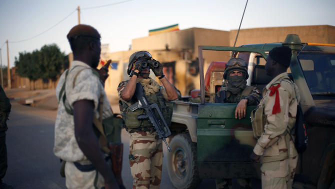 French and Malian soldiers check for snipers during exchanges of fire with jihadists in Gao, northern Mali, Sunday, Feb. 10, 2013.  (AP Photo/Jerome Delay)