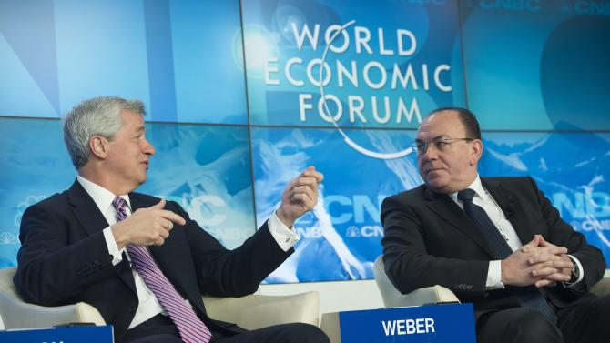 Big banks, under pressure,  on defense at Davos