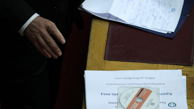 The new draft state budget for 2013 is seen on a desk at the Greek parliament in Athens, Wednesday, Oct. 31, 2012. Greek lawmakers are to vote Wednesday on a privatization bill that will be the first major test for the country's troubled governing coalition, while journalists have walked off the job at the start of rolling 24-hour strikes to protest austerity plans that will affect their healthcare funds. (AP Photo/Thanassis Stavrakis)