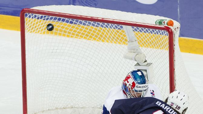 Team USA forward Cole Bardreau (18) scores past Slovakia goalie Adam Nagy during first period IIHF World Junior Championships hockey action in Ufa, Russia on Monday, Dec. 31, 2012. (AP Photo/The Canadian Press, Nathan Denette)