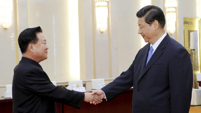 In this photo released by China's Xinhua News Agency, Chinese President Xi Jinping, right, greets North Korean Vice Marshal Choe Ryong Hae in Beijing Friday, May 24, 2013. The top North Korean envoy delivered a letter from leader Kim Jong Un to Xi on Friday and told him Pyongyang would take steps to rejoin stalled six-nation nuclear disarmament talks, in an apparent victory for Beijing's efforts to coax its unruly ally into lowering tensions. (AP Photo/Xinhua, Rao Aimin) NO SALES