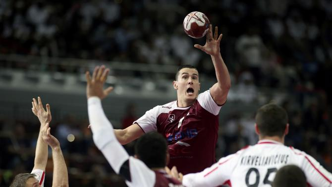 Markovic of Qatar jumps for a ball during the round of 16 match against Austria in the 24th men's handball World Championship in Doha