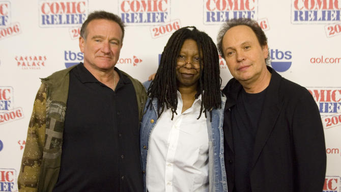 "FILE - This Nov. 18, 2006 file photo shows comedians Robin Williams, from left, Whoopi Goldberg and Billy Crystal posing after hoasting ""Comic Relief"" at Caesars Palace Hotel and Casino in Las Vegas, Nev. Williams, whose free-form comedy and adept impressions dazzled audiences for decades, has died in an apparent suicide. He was 63. The Marin County Sheriff's Office said Williams was pronounced dead at his home in California on Monday, Aug. 11, 2014. The sheriff's office said a preliminary investigation showed the cause of death to be a suicide due to asphyxia. (AP Photo/Keith Shimada, File)"