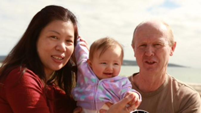 "In this image taken from video supplied Sunday, Aug. 10, 2014 by Channel 9's ""60 Minutes"", David Farnell, right, his wife Wendy, left, pose with baby Pipah in Australia. The Australian couple, David and his wife Wendy Farnell, has denied that they abandoned their son born with Down syndrome to a Thai surrogate. The couple said in the interview that the boy's surrogate mother, Pattaramon Chanbua, insisted she be allowed to keep the boy and that she threatened to also keep his twin sister Pipah. (AP Photo/Channel 9 60 Minutes) AUSTRALIA OUT, NO SALES, EDITORIAL USE ONLY"