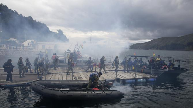 Members of an anti-narcotics police force participate in a joint demonstration, with their counterparts from the military, in Lake Titicaca at Tiquina