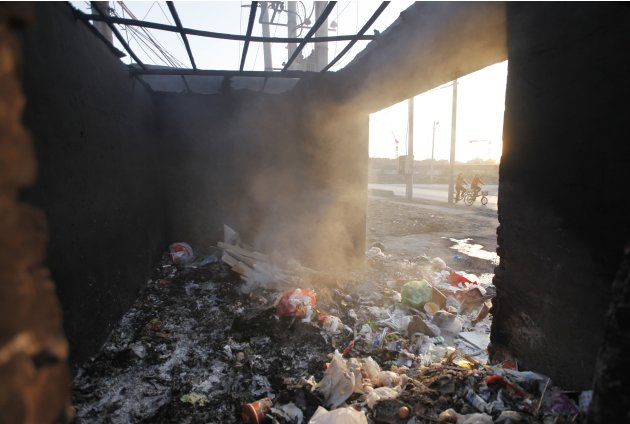 Household garbage is burned in an open air garbage room in Beijing