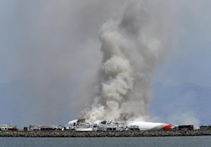 Smokes rises from Asiana Flight 214 after it crashed …