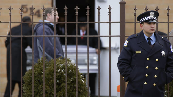A Chicago police officer guard as the remains of 15-year-old Hadiya Pendleton arrive at the Greater Harvest Missionary Baptist Church for funeral services Saturday, Feb. 9, 2013, in Chicago. The shooting death of the 15-year-old honor student has drawn attention to the staggering gun violence in the nation's third-largest city. (AP Photo/Nam Y. Huh)