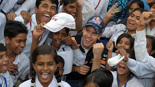 Sebastian Vettel with Indian children at the race track Buddh International Circuit