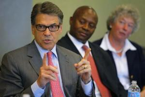 Texas Governor Perry speaks during appearance at business leaders luncheon in Portsmouth