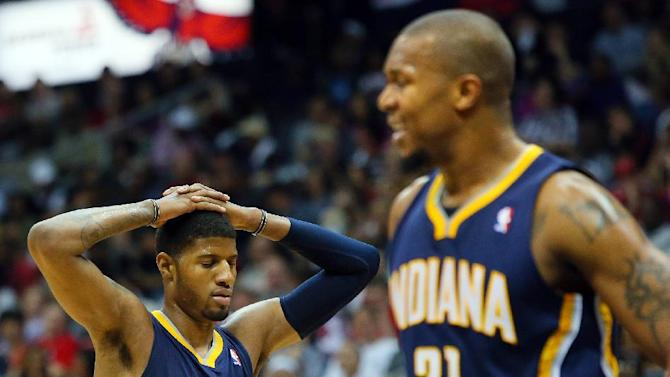 Indian Pacers Paul George, left, and David West react in the second half as the Atlanta  Hawks defeat the Pacers 102-91  in Game 4 of their first-round NBA basketball playoff series game Monday, April 29, 2013, in Atlanta. The win ties the first round series 2-2.   (AP Photo/ Journal-Constitution, Curtis Compton)