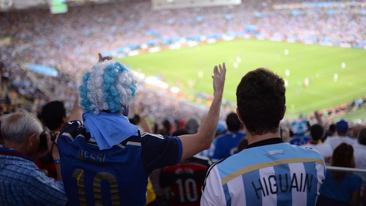 Argentina fans cheer for their team during the final World Cup match between Argentina and Germany at the at Maracana Stadium in Rio de Janeiro, Brazil, Sunday, July 13, 2014. (AP Photo/Manu Fernandez)