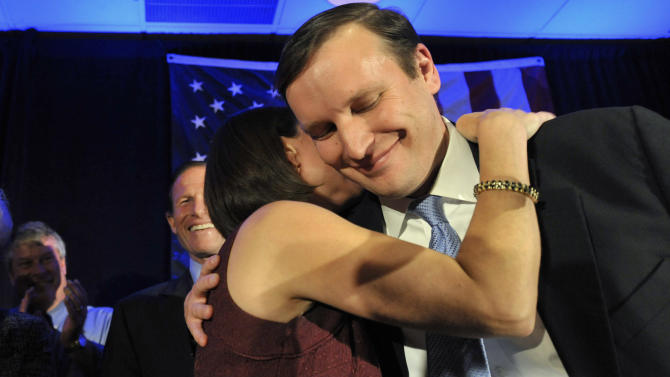Newly elected Democratic Sen. Chris Murphy celebrates his win with wife Cathy Holahan Murphy over Republican Linda McMahon in Hartford, Conn., Tuesday, Nov. 6, 2012.  (AP Photo/Jessica Hill)
