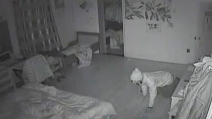 Chilling Video Shows Burglar Crawling Into Family's Bedroom While They Sleep: Cops