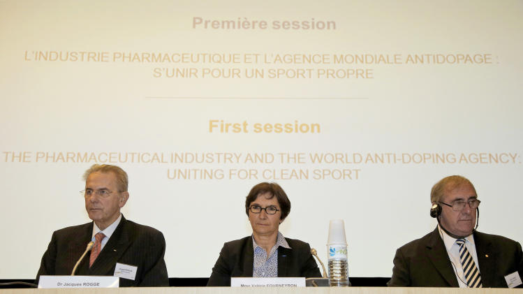 "International Olympic Commitee President Jacques Rogge, left, French Sports minister Valerie Fourneyron and and John Fahey, the head of the World Anti-Doping Agency, right, attend a symposium called ""The Pharmaceutical Industry and the Fight against Doping : New Partnerships for Clean Sport"" in Paris Monday, Nov. 12, 2012. The international conference is looking at ways to unite the pharmaceutical industry and sports authorites in the fight against doping (AP Photo/Francois Mori)"