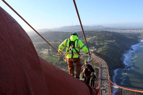 Golden Gate Bridge electrician on main cable. © Golden Gate Bridge, Highway and Transportation District. Used with permission. www.goldengate.org