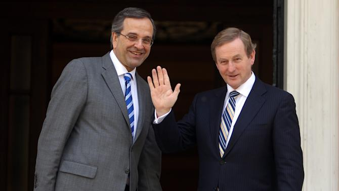 "Greece's Prime Minister Antonis Samaras, left and his Irish counterpart Enda Kenny wave to the media prior to their meeting at Maximos Mansion in Athens, Thursday, May 23, 2013. Samaras said that Greece would follow the ""same successful model"" as Ireland both of the EU presidency and to exit the crisis. Ireland's EU presidency will finish in the end of June. Greece is scheduled to take over the EU's rotating six-month presidency in January 2014. (AP Photo/Thanassis Stavrakis)"