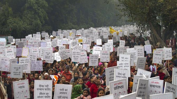 FILE - In this Wednesday, Jan. 2, 2013 file photo, Indian women carry placards as they march to mourn the death of a gang rape victim in New Delhi, India. For decades, women have had little choice but to walk away when groped in a crowded bus or train, or to simply cringe as someone tosses an obscene comment their way. Even if they haven't experienced explicit sexual abuse themselves, they live with the fear that it could happen to them or a loved one. The gang rape and beating of a 23-year-old university student on a moving bus in India's capital has taken sexual violence - a subject long hidden in the shadows of Indian society - and thrust it into the light. (AP Photo/ Dar Yasin, File)