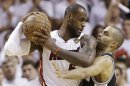 San Antonio Spurs guard Tony Parker (9) and Miami Heat forward LeBron James (6) collide during the second half of Game 6 of their NBA Finals basketball series, Tuesday, June 18, 2013 in Miami. (AP Photo/Lynne Sladky)