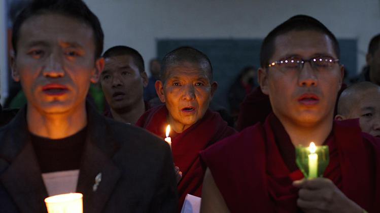 Exile Tibetans participate in a candlelit vigil to show solidarity with self-immolators in Tibet in Dharmsala, India, Wednesday, Nov. 28, 2012. At least 86 people have set themselves on fire since the immolations began in 2009. (AP Photo/ Ashwini Bhatia)